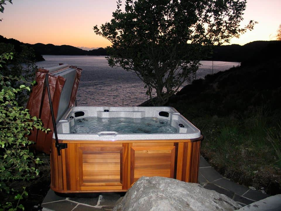Arctic Spas Hot tub next to the lake