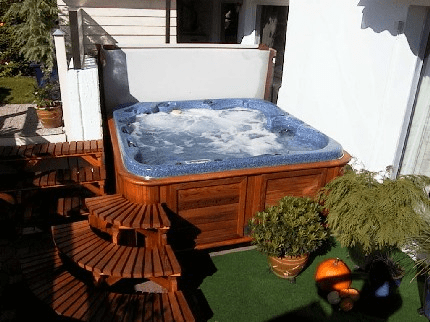 arctic spas hot tub tucked in corner